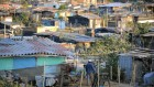 View of the Bendicion de Dios slum in Soyapango, a suburb east of San Salvador on March 11, 2009. The slum, which was formerly a dump, is the home of around 5000 homeless people, who wait for next government to solve their irregular settlement in the land.  AFP PHOTO/ Jose CABEZAS